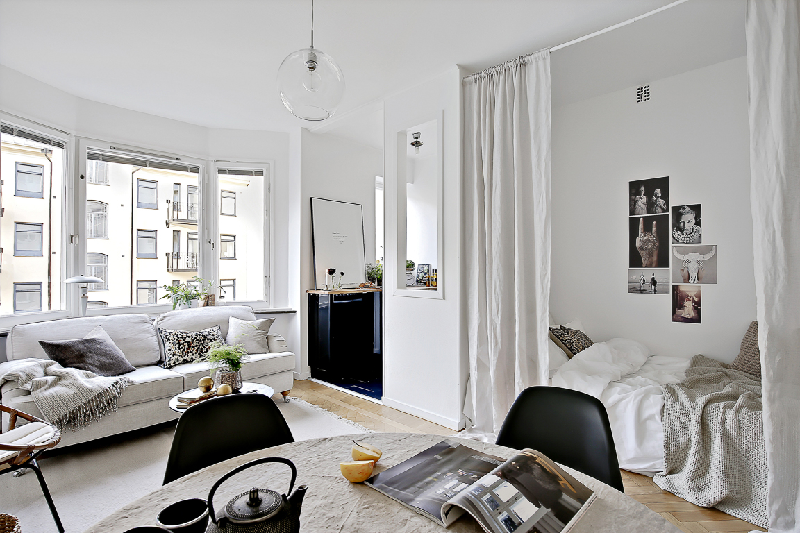 If you don't want to replace the walls, the next best thing is to use a huge area rug, curtains, or furniture to create a striking contrast. How To Create A Bedroom Inside A Tiny Studio Apartment?