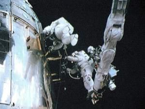 Two astronauts repair the Hubble telescope