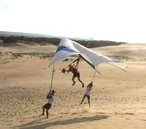 Randy Gray takes flight in a hang glider
