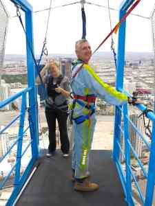 Malcolm Logan at the top of the Statosphere Tower preparing to jump.
