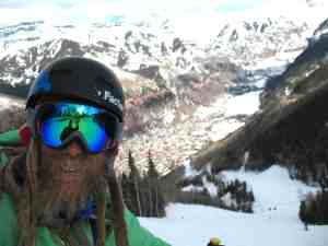 Jaimé Palmer with the town of Telluride, Colorado below him