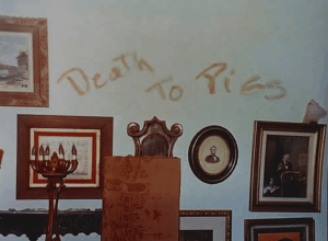 Death to Pigs scrawled on the wall