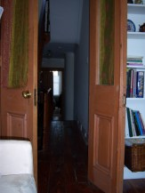 The double doors and built-in shelves on the second floor