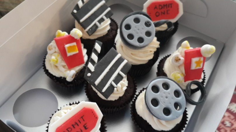Fondant movie-themed designs on chocolate cupcakes