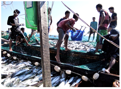 Fishermen working on the boat, Ngapali, Myanmar