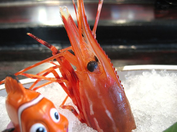 The head is served with tentacles still wriggling, but is not eaten at this stage (and you'd be a fool to try).