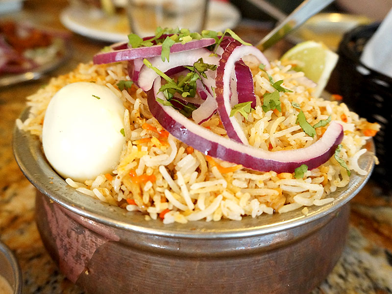 """This is the Hyderabadi Chicken Dum Biryani. Given the presence of the word """"biryani"""" in the group's name I had high hopes for this but it was just so-so. Now, it may well be the best biryani in the region as one person on Chowhound described it, but that's not saying much in and of itself. The rice was too soft and didn't really have the aroma/flavour of the chicken bound to it."""