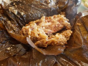 Spareribs cooked with sticky rice in a dried lotus leaf wrapper. Fatty pork and rice on the verge of becoming one.
