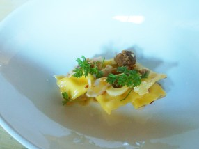 Hearts of palm agnolotti with razor clams, merguez sausage and chervil