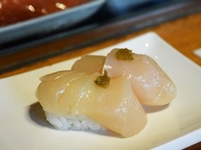 I unaccountably failed to take close-up pictures of the remaining items on the set nigiri combo; from here on out everything was added on 2 pcs at a time from their menu. This scallop, garnished with grated yuzu peel was fine but not quite as sweet as I like.