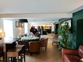 View from the shop into the bright and comfortable lounge with a bar at one end where some of the tasting-centred tours seem to meet.