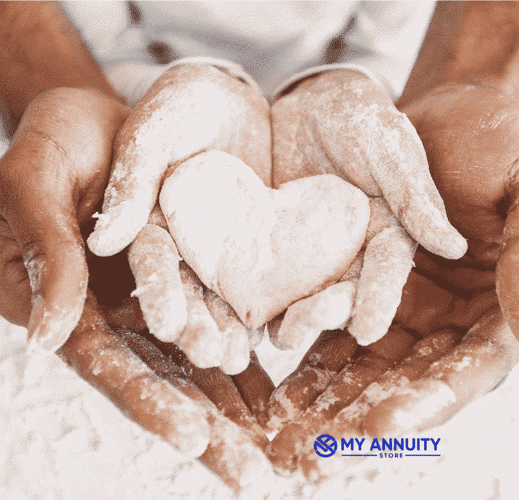 Adult female's hands cupping childs hands holding clay in shape of heart - free life insurance quotes online at my annuity store, inc.