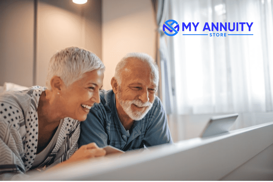 Retired woman and man leaning over desk planning finances online - 4 step process to help women prepare for retirement