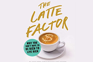 The LAtte Factor cover - white cup on saucer full of coffee with a dollar sign drawn in the creme