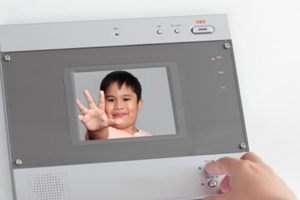 Adult viewing a child on a connected security device