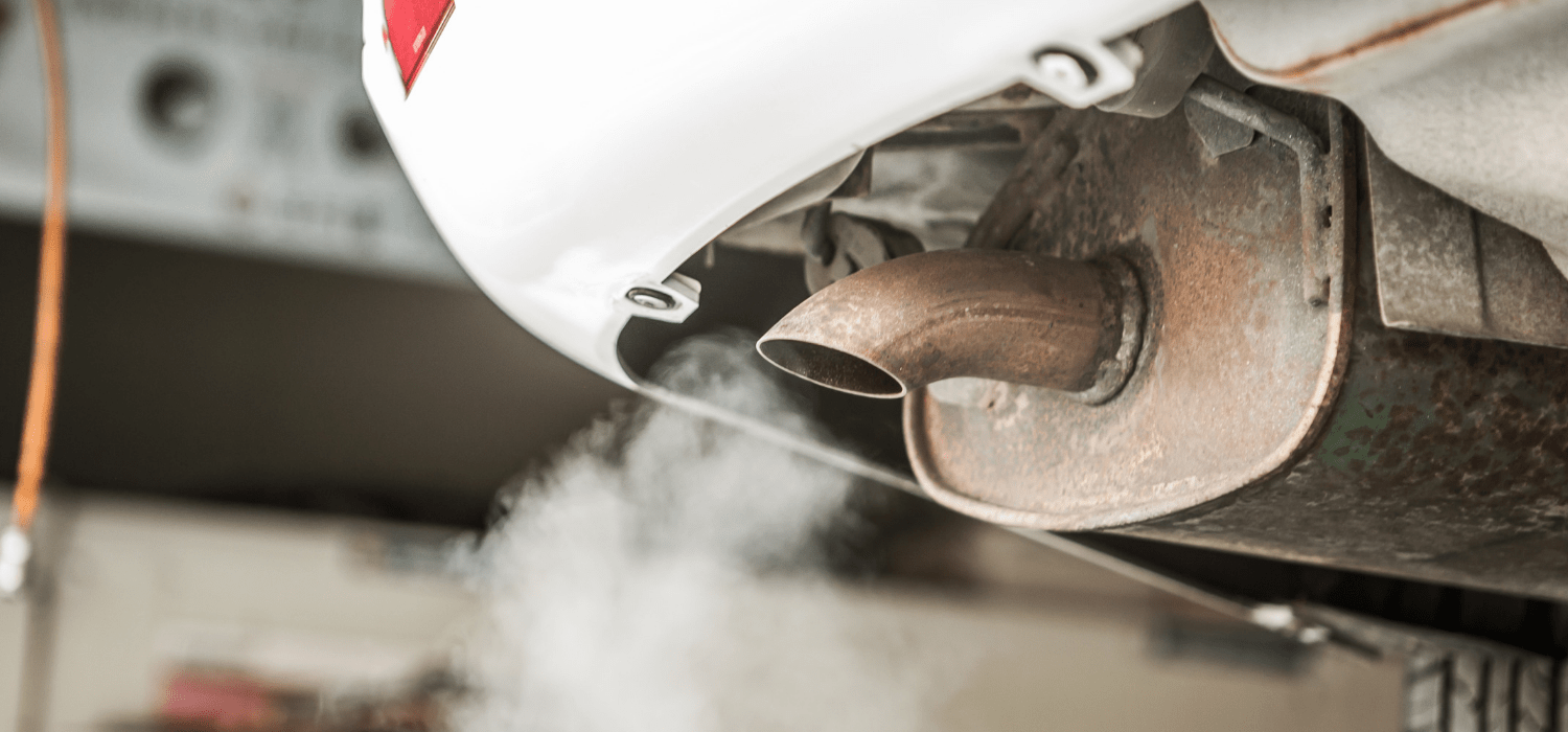 vehicle emissions leaving a car exhaust