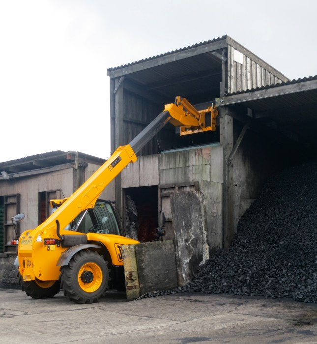 Beautifully clean and new JCB working in the coal yard