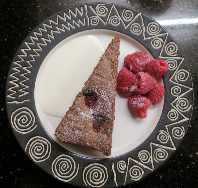 Served with raspberries and cream