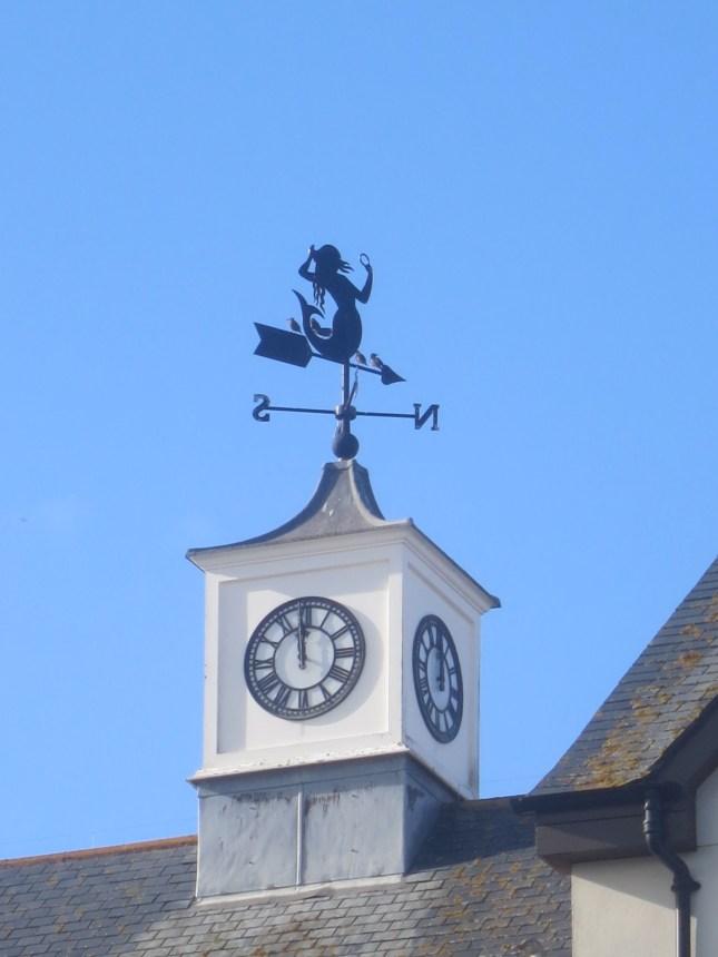 Clock tower with mermaid