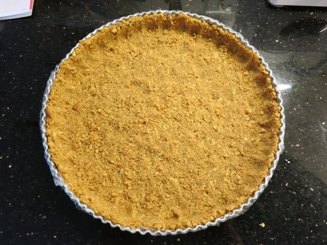 Crumb mixture pressed into the tin