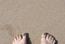 Sandy feet, blue toes