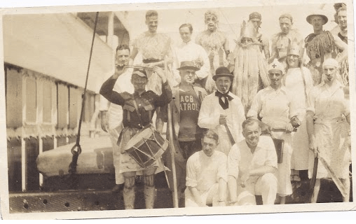 Dr Homer Speer Sr onboard a world cruise with fellow travellers suited up in costumes