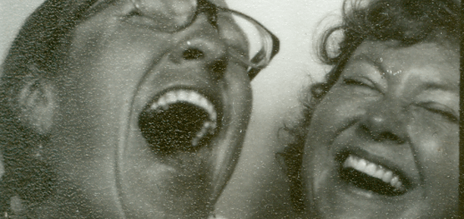 Two women laughing in film booth