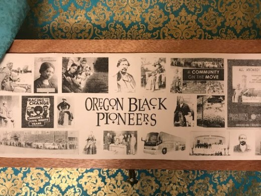Green and gold brocade background. Wooden box with collage to commemorate 25th Anniversary Oregon Black Pioneers