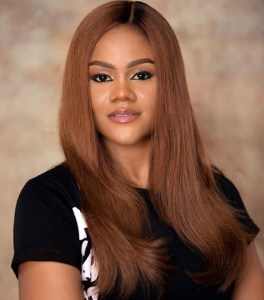 Busola Dakolo with nice hair and cute smile