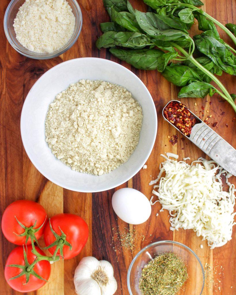 Low Carb Pizza Crust Ingredients: mozarrella, parmesan, fresh basil, tomatoes, pepper flakes, egg, garlic, italian seasoning