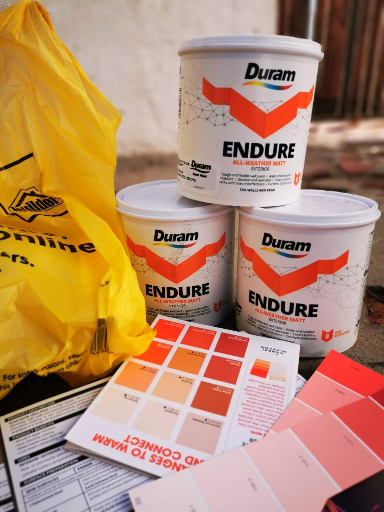 tins of paint and paint guides all in different shades of orange.