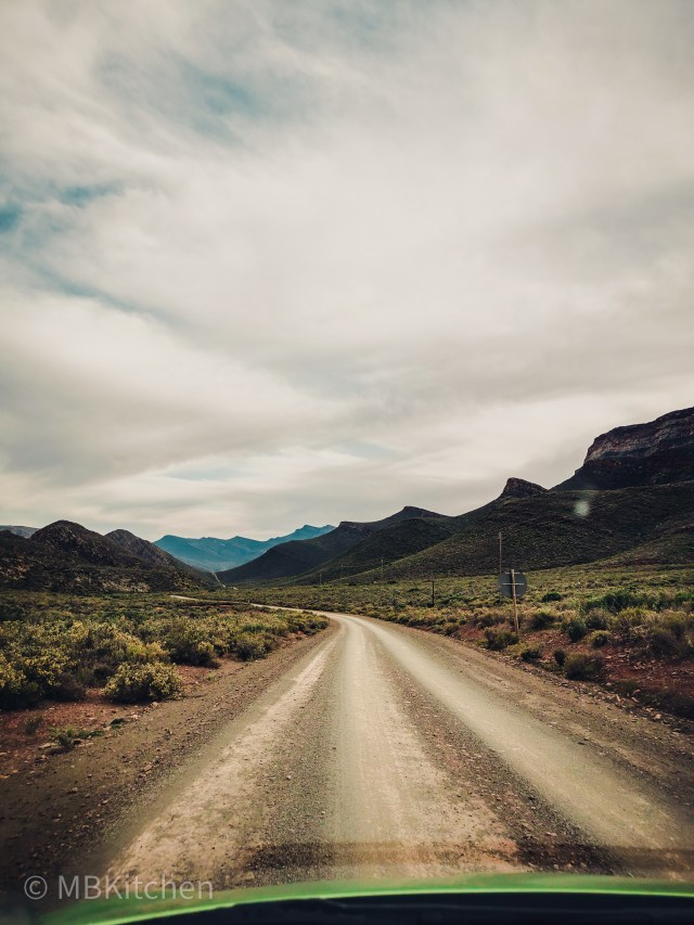 gravel road and mountains