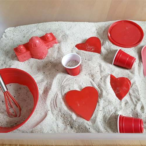 Toddler Valentine's Day Sandbox sensory play activity