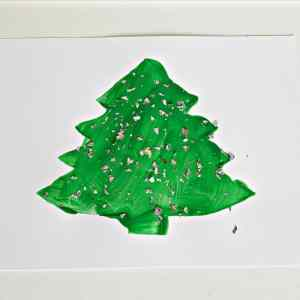 Christmas tree stencil craft painting activity for toddlers