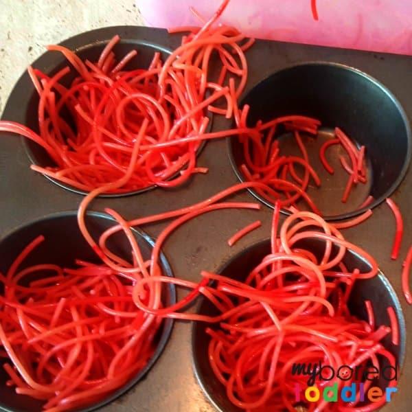how to make colored spaghetti for messy play sensory play sensory bins 2