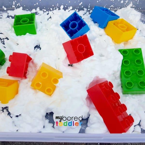 messy play blocks in shaving cream or whipped cream