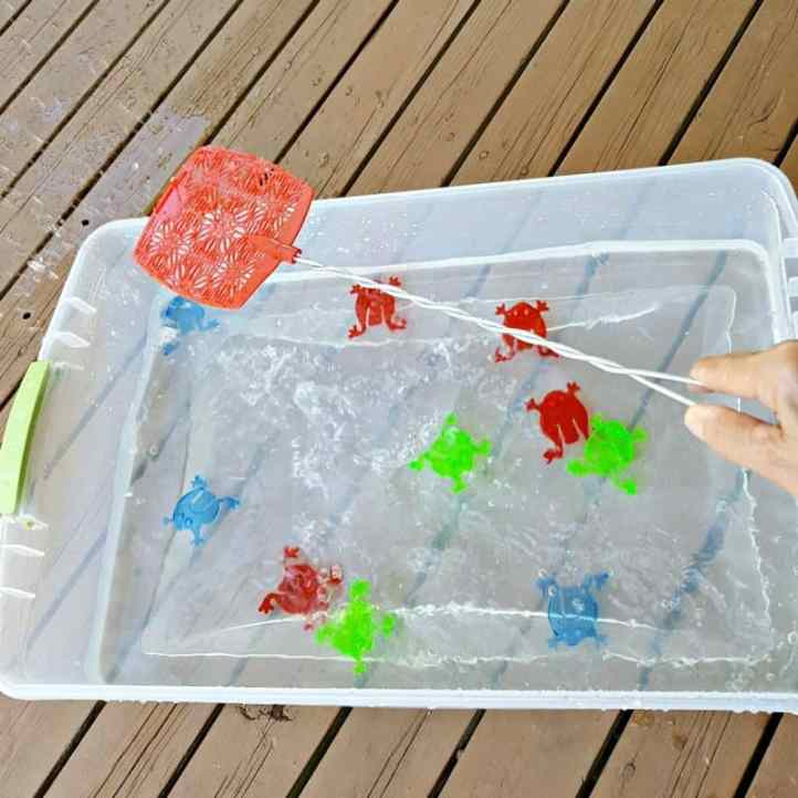 water play activity with a fly swatter