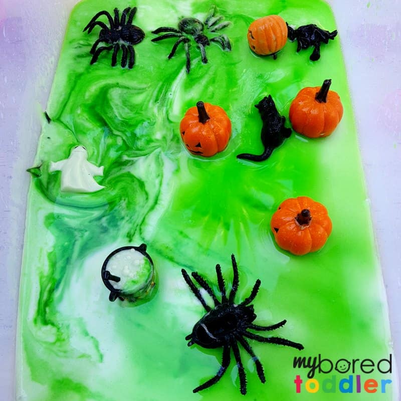Halloween science fizzing sensory bin for toddlers pumpkins and spiders