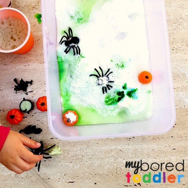 Science sensory bin Halloween sensory bin fizzing fizzy spiders and pumpkins toddlers
