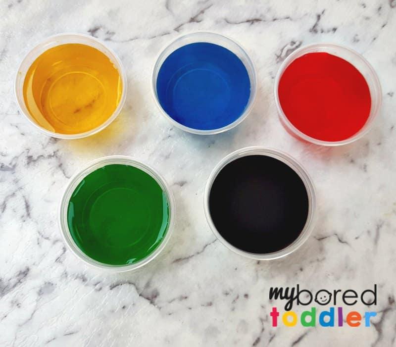 fizzing sensory bin for toddlers colors vinegar baking soda mixing setup