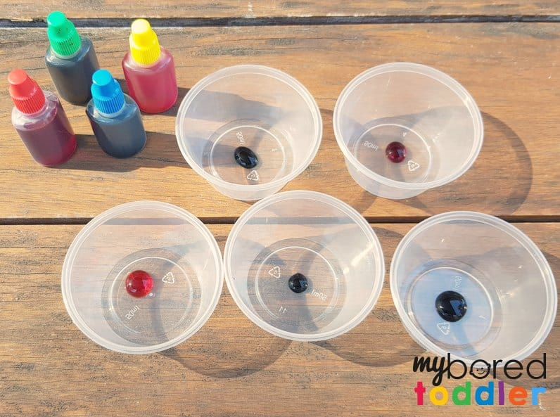fizzing sensory bin with colors and baking powder and vinegar setup 3
