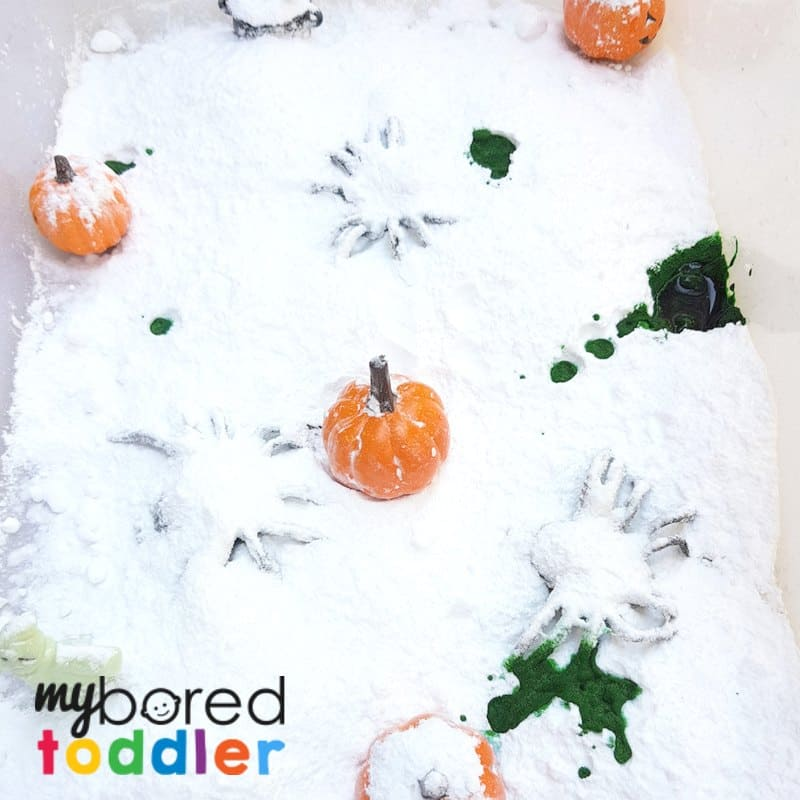 halloween fizzing science sensory bin with baking soda and vinegar stem steam adding food coloring