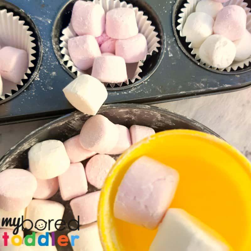 marshmallow sensory bin playing 1