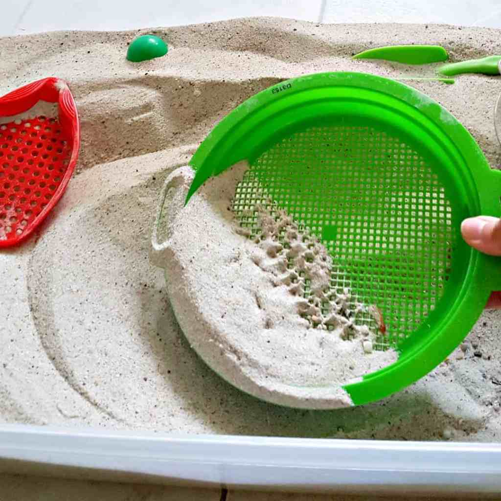 Sandbox play with sifters – simple sand play for toddlers