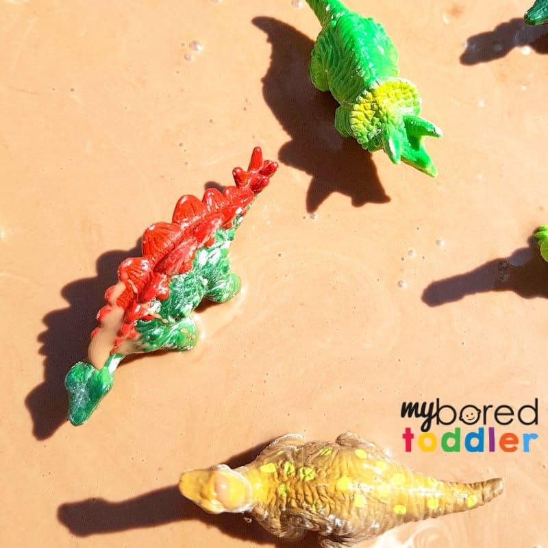 Taste safe muddy dinosaur sensory bin