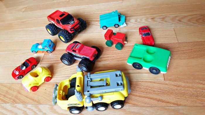 Toy cars and trucks can be used for a color sorting activity with toddlers