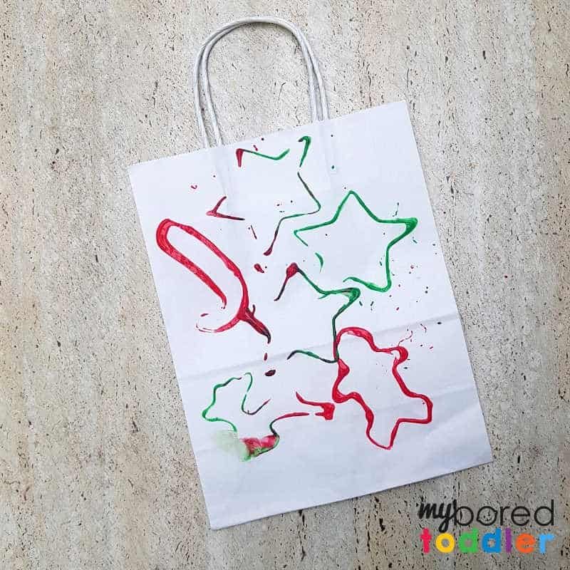 stamped gift bag craft for toddlers and preschoolers finished logo