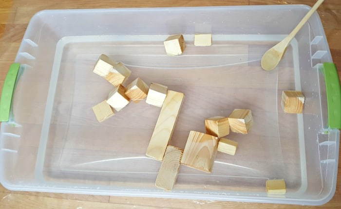 Add small wood blocks and wooden spoon to water bin