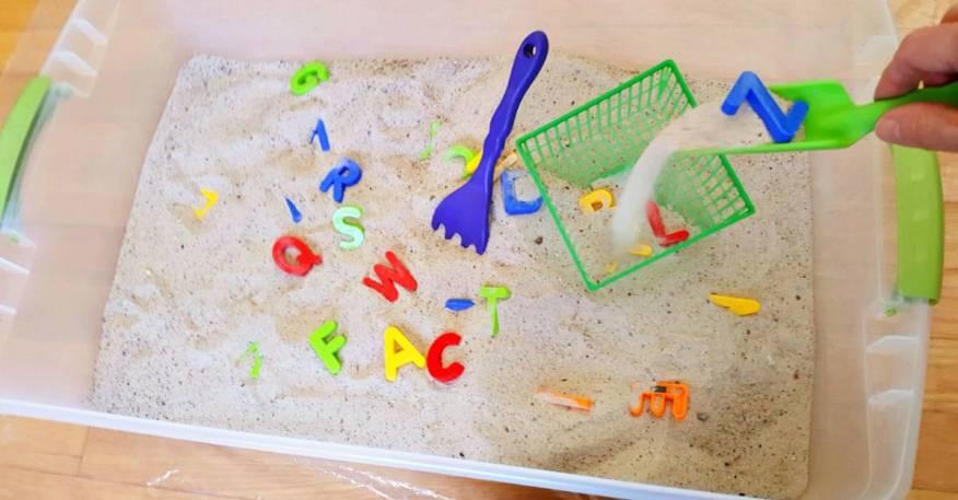 Toddler sandbox sensory and literacy activity