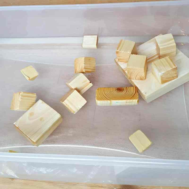 Toddler water play with wood blocks